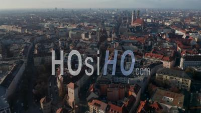 Famous Isa Tor City Gate In Munich, Germany With Little Traffic Due To Coronavirus Covid 19 Pandemic, Aerial View Above German Cityscape With Frauenkirche And New Town Hall - Video Drone Footage