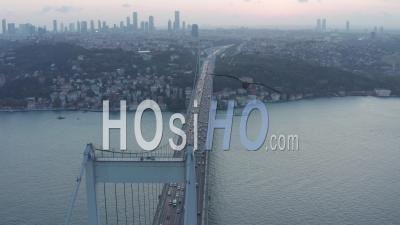 Big Bridge Leading Into The City Skyline, Car Traffic At Sunset In Istanbul, Aerial Dolly Slide Left - Video Drone Footage