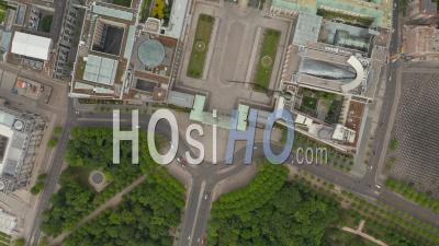 Aerial Slow Overhead Top Down View Circling Over Empty Brandenburg Gate In Berlin Central During Coronavirus Covid-19 Pandemic And Stay At Home Regulation In May 2020 - Video Drone Footage