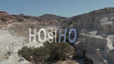 Aerial Dolly Through Beautiful Sarakiniko Lunar Volcanic Canyon With Dry Desert Surrounding In Milos Island, Greece 4k - Video Drone Footage