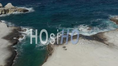 Aerial Birds Eye View Of Ocean Waves Crashing On White Rocks In Greece 4k - Video Drone Footage