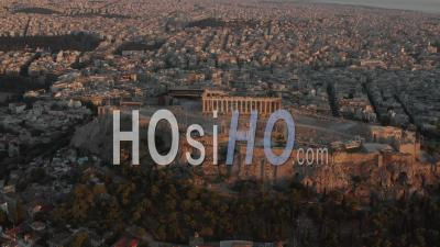Aerial Perspective Circling Acropolis Of Athens In Golden Hour Sunset Light 4k - Video Drone Footage