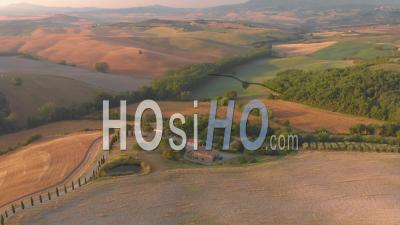 Aerial Landscape Of The D'orcia Valley In Tuscany With Scenic Mansion, Green Hills And Yellow Fields On Summer - Video Drone Footage