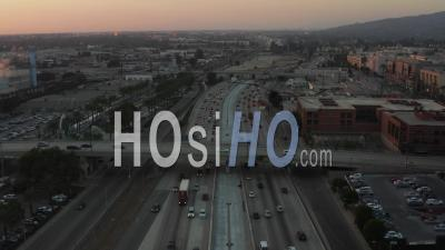 Over Busy Highway At Sunset With Palm Trees In Burbank, Los Angeles, California, Sunset 4k - Video Drone Footage