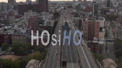 Aerial Dolly View Of Multi Lane Car Traffic Across Manhattan Bridge Towards Residential Buildings In Chinatown And Stopped Police Car With Flashing Lights On The Bridge 4k - Video Drone Footage