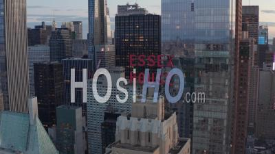 Close Up Of Essex House Manhattan Skyline At Wonderful Sunset With Flashing City Lights In New York City At Central Park In Beautiful 4k - Video Drone Footage