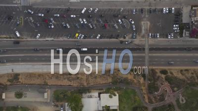 Birds Eye View Of Santa Monica Pier, Los Angeles Parking Lot And Pacific Coast Highway Pch With Cars Entering The Freeway 4k - Video Drone Footage