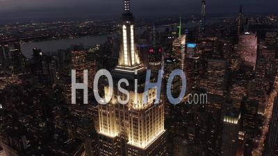 Flying Above Lit Up Parallel Avenues And Junctions, Residential Condominiums And Office Buildings In Midtown Manhattan, New York City At Night. Road Infrastructure In Metropolis 4k - Video Drone Footage