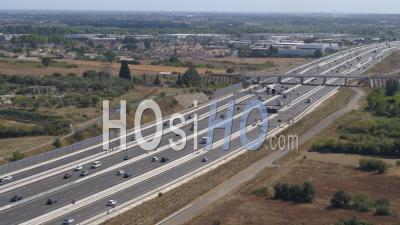 Toll Booth Baillargues-Montpellier With White Semi Truck In The Morning With Moderate Traffic - Video Drone Footage
