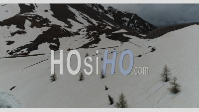 Snow Removal Work For The Opening Of The Col D'izoard In Spring, Hautes-Alpes, France, Viewed From Drone