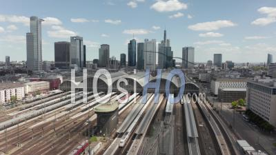 Aerial View Forward Flight Over Frankfurt Am Main, Germany Central Train Station Train Tracks With Skyline View On Beautiful Summer Day With Little Traffic Due To Coronavirus Covid 19 Pandemic - Video Drone Footage