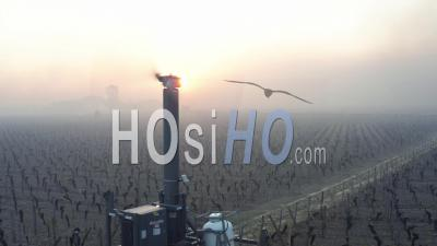 Aerial View, Anti-Frost Wind Machine In Bordeaux Vineyard During Sub-Zero Temperatures Of 7 April 2021 - Video Drone Footage
