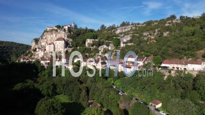 Medieval Village And Sanctuary Of Rocamadour Clinging To A Cliff Dominating The Azou Valley In Lot, France, Viewed From Drone
