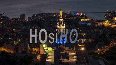 Establishing Aerial View Shot Of Marseille Fr, Bouches-Du-Rhone, Provence-Alpes-Cote D'azur, France At Night Evening, Basilica Of Notre-Dame-De-La-Garde - Video Drone Footage