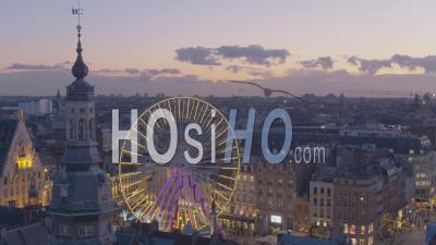 Christmas Wheel And Beffroi In Grand Place Of Lille At Sunset - Video Drone Footage